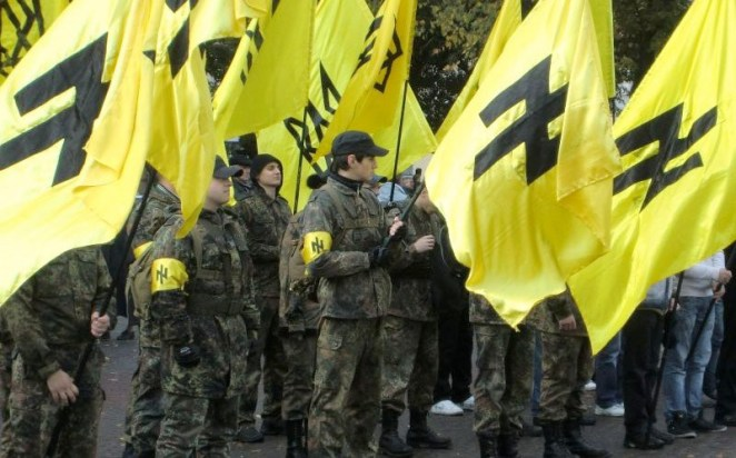 "The Ukrainian Azov Brigade carrying banners displaying the SS-rune ""Wolfsangel"""